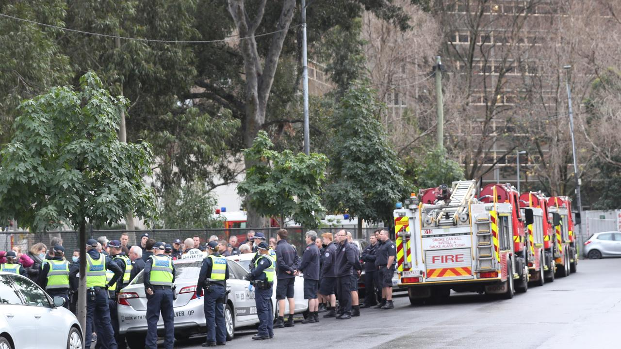 Firefighters and police delivering food to one of the nine towers which went into lockdown before the entire state followed. Picture: David Crosling