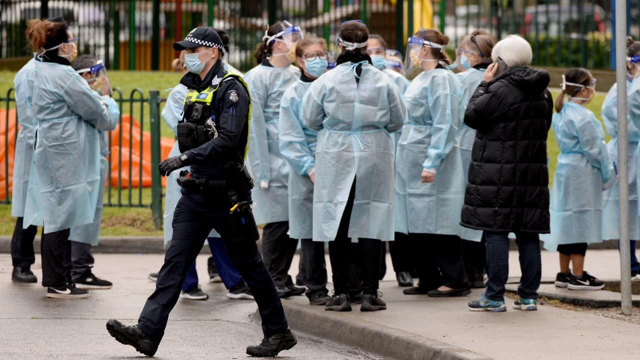 Dozens of workers put on their PPE before heading into the locked down towers. Picture: Andrew Henshaw