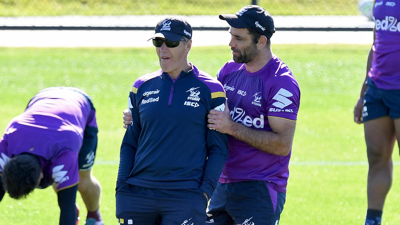 LOCALS NOW? Cameron Smith chats with Coach Craig Bellamy during a Melbourne Storm NRL training session at Sunshine Coast Stadium on July 07, 2020 in Sunshine Coast, Australia. (Photo by Bradley Kanaris/Getty Images)