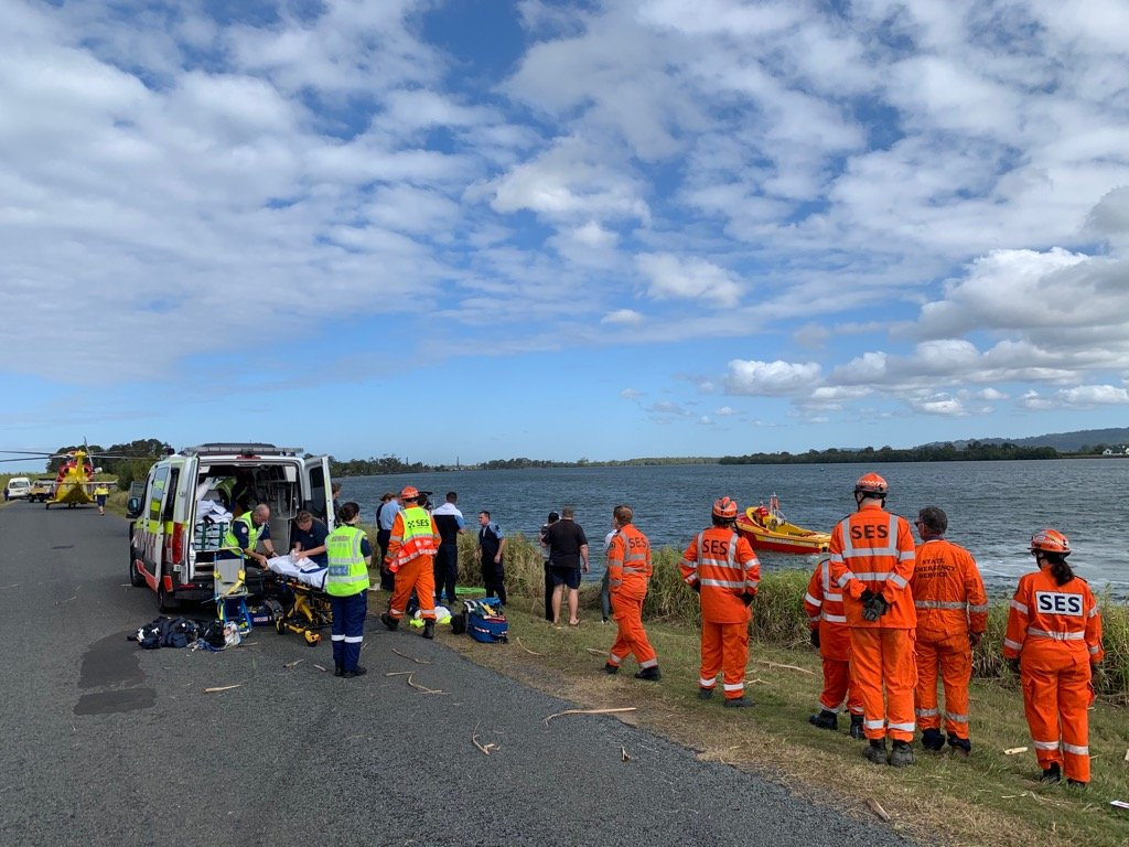 Emergency services at the scene at South Ballina where a car plunged into the river.