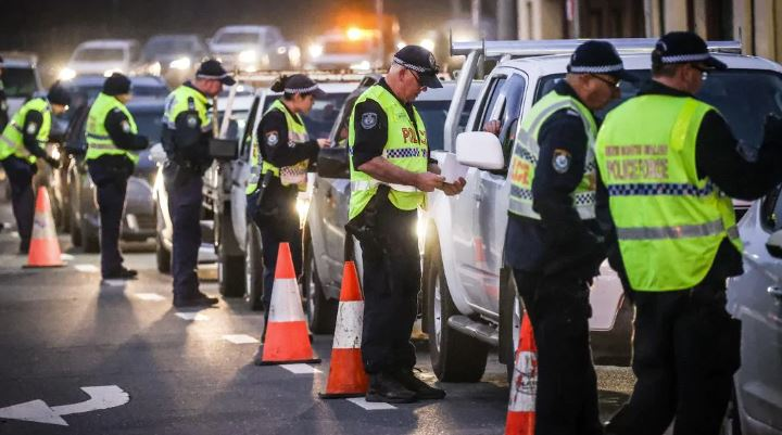 Police stop and question drivers at a checkpoint on July 8 in Albury, Australia. The NSW-Victoria border closed at midnight, Wednesday 8 July. It is the first. Picture: Getty