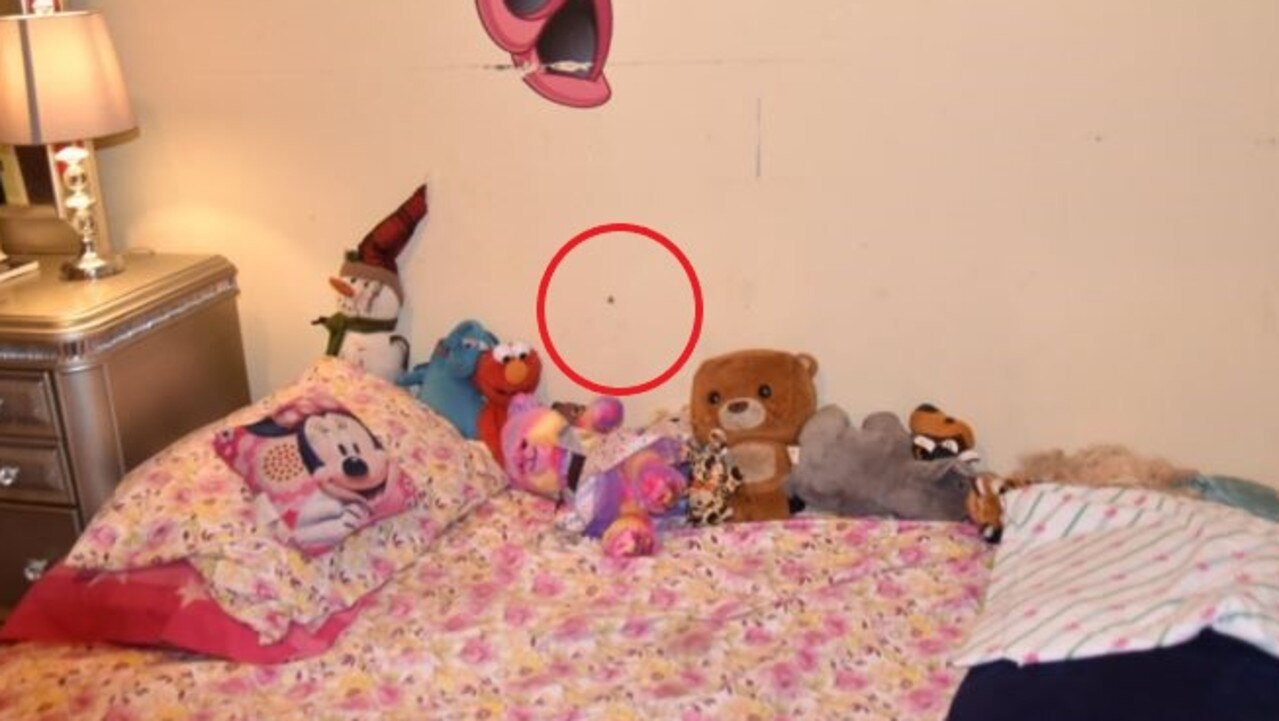 The photo shows how a bullet from a shooting outside managed to pierce the wall of a little girl's bedroom.