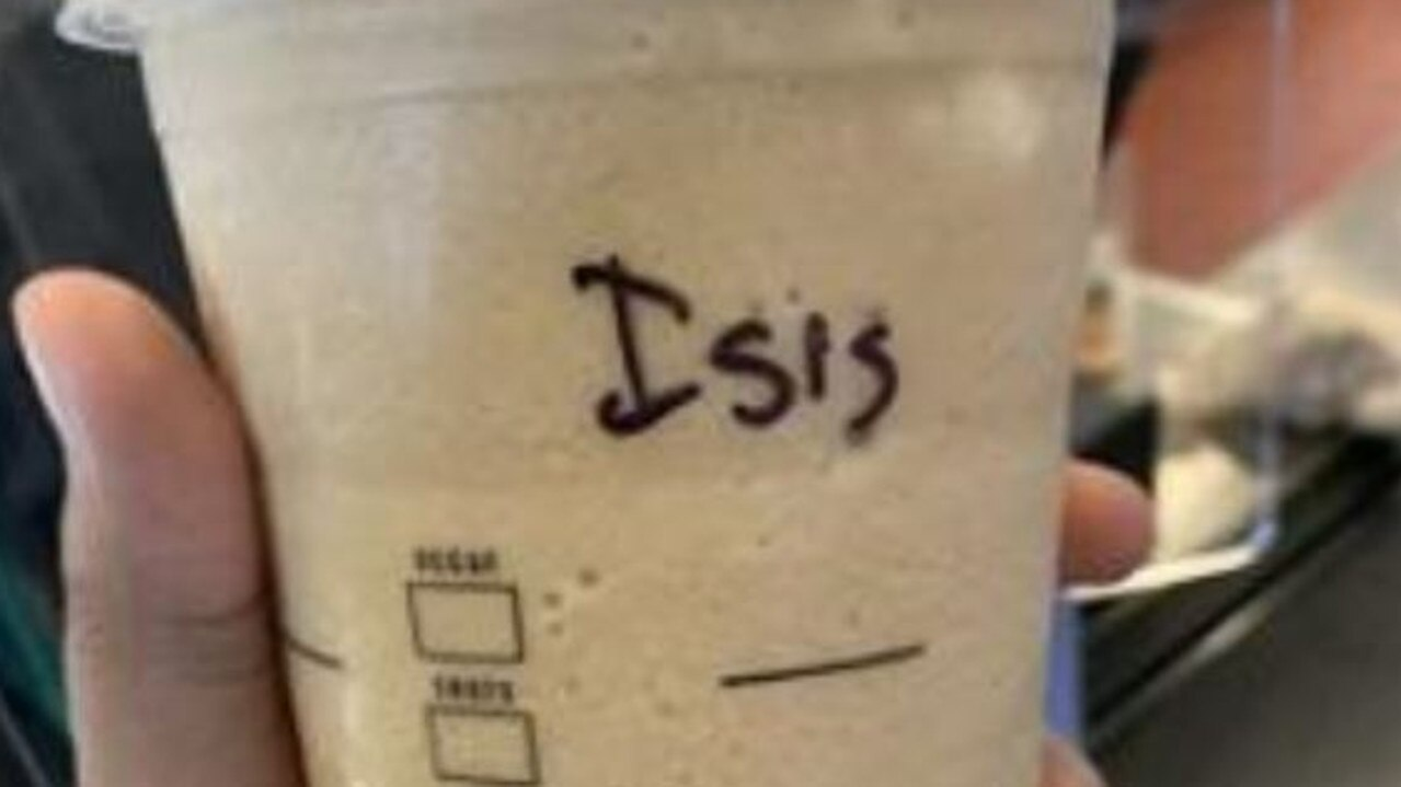 A woman has described the moment she picked up her coffee order and saw the offensive word the barista had scrawled on the side.