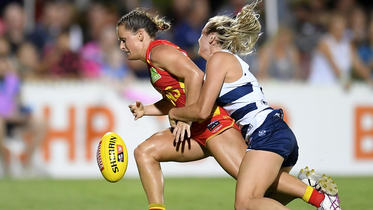 Kate Surman of the Suns is tackled by Amy McDonald of the Cats during the round five AFLW match between the Gold Coast Suns and the Geelong Cats at Great Barrier Reef Arena. Photo by Albert Perez/Getty Images