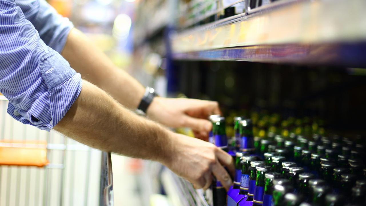 Man buying beer.