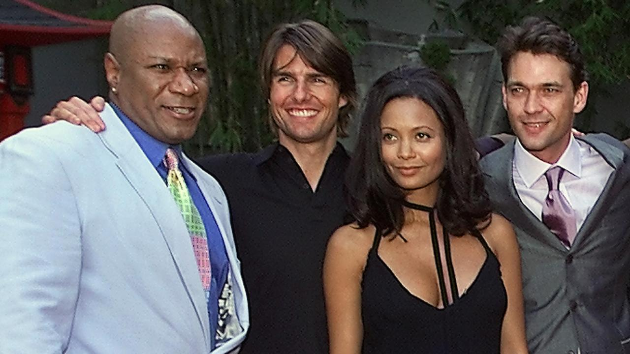 Big smiles and not a zit in sight: Mission: Impossible 2 stars (L) Ving Rhames, Tom Cruise, Thandie Newton and Dougray Scott at the Hollywood premiere in 2000. Picture: AP PicKevork/Djansezian
