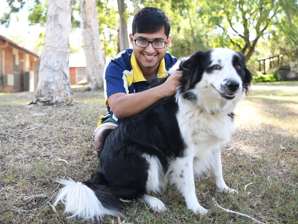 Jeet Mukherjee at home on CQUniversity's North Rockhampton campus with Nala, whom he calls his lockdown therapy dog