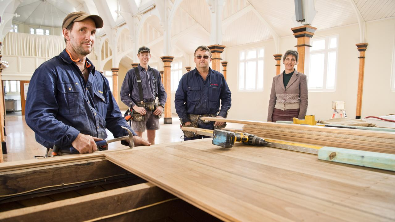 NEW FLOOR: Working on the St Luke's Parish Hall constructions are (from left) Paul Spence Constructions' Steven Mauch, Duncan Hancock and Paul Spence with architect Stephanie Keays. Picture: Nev Madsen