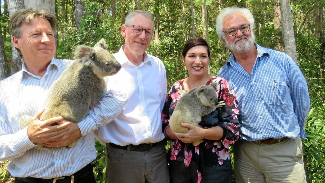 Former Noosa Mayor Tony Wellington, with HQPlantations' David West, Environment Minister Leeanne Enoch and NPA's Michael Gloster mark the forest land deal.