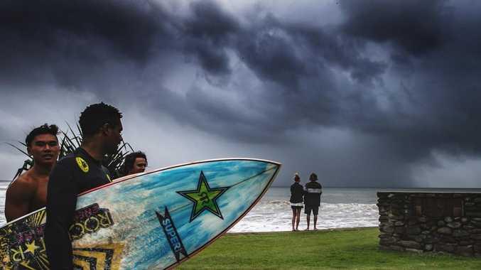 Downpour drops month's worth of rain over Coast