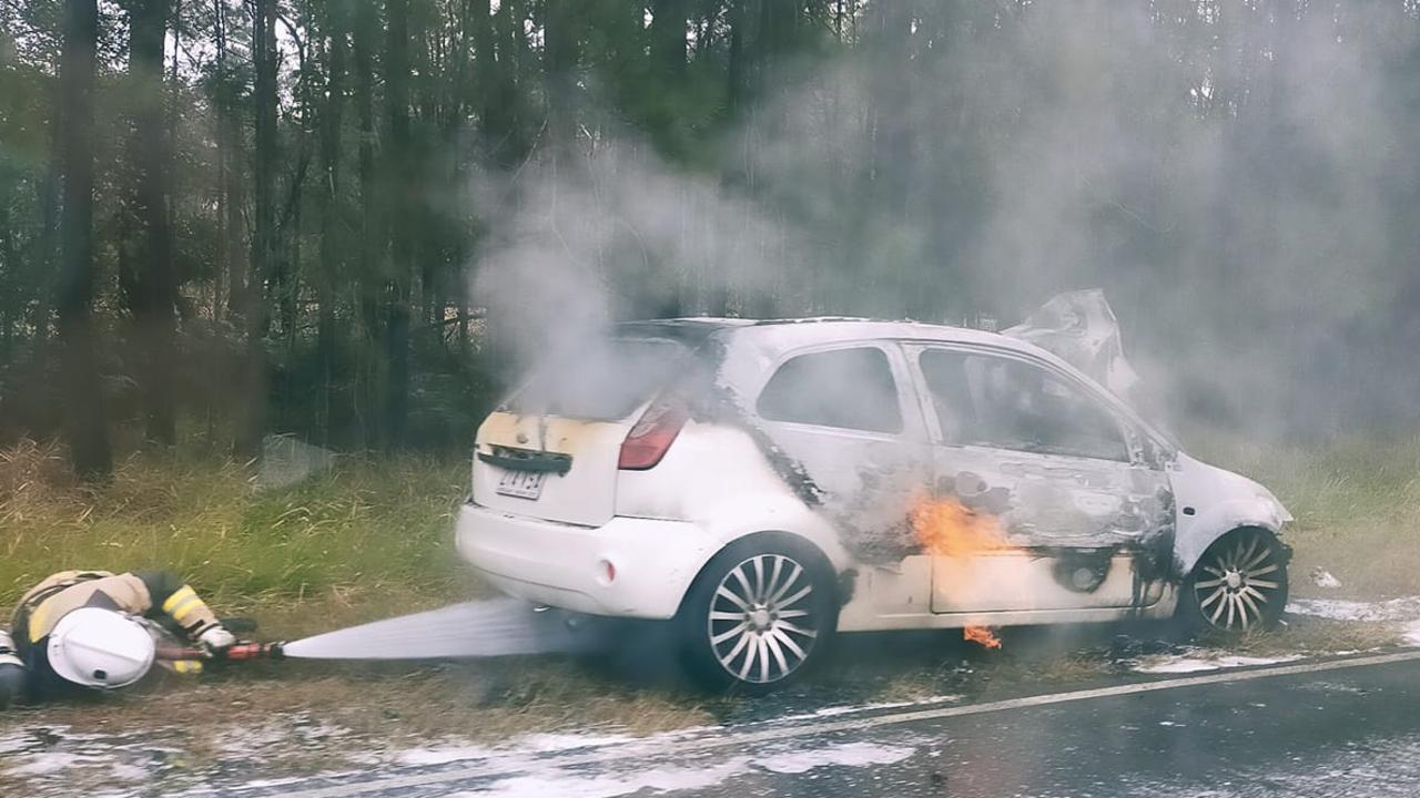 A car has caught fire following a crash on Steve Irwin Way, Landsborough.