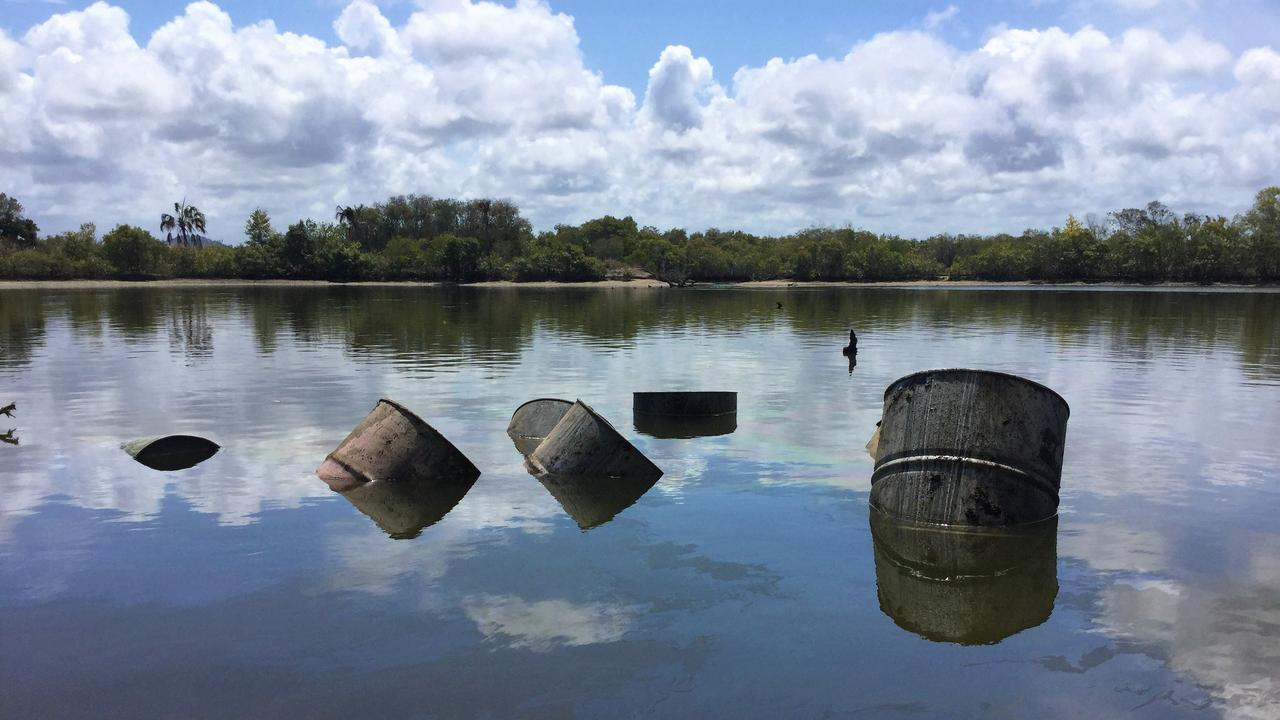 Drums dumped in a lagoon North of Yeppoon