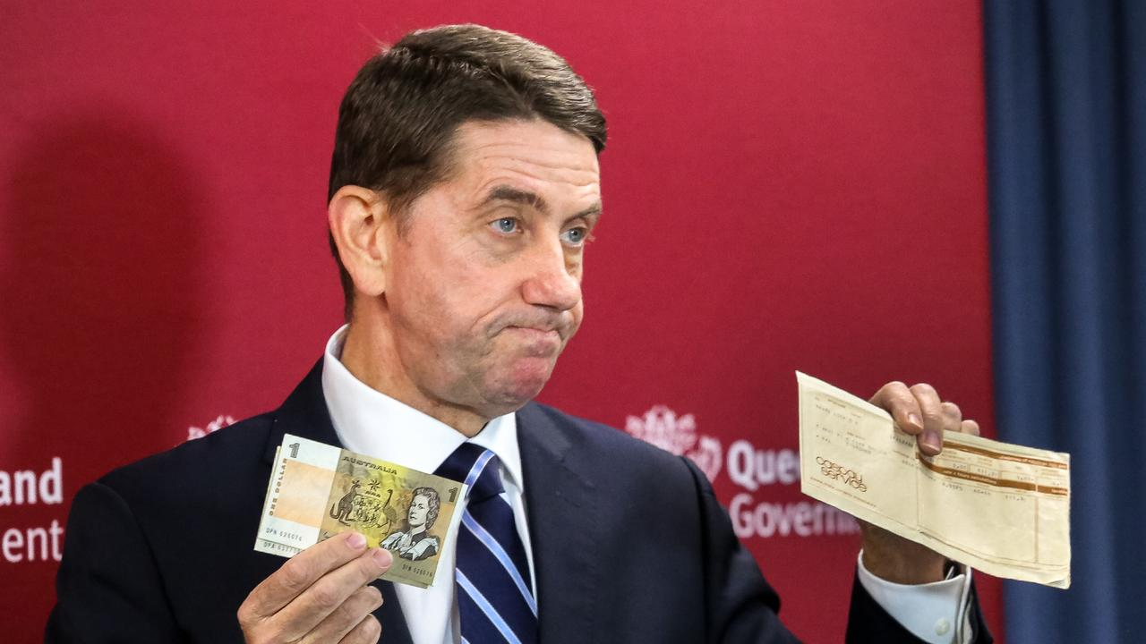 Treasurer Cameron Dick shows the media his first pay check, earned working in a Garden City deli. Pic: NCA NewsWire/David Kapernick
