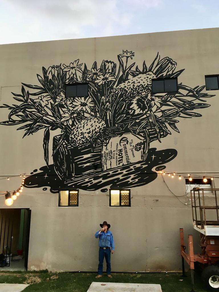 Artist Dave Faint and his mural at the Clermont Commercial Hotel.