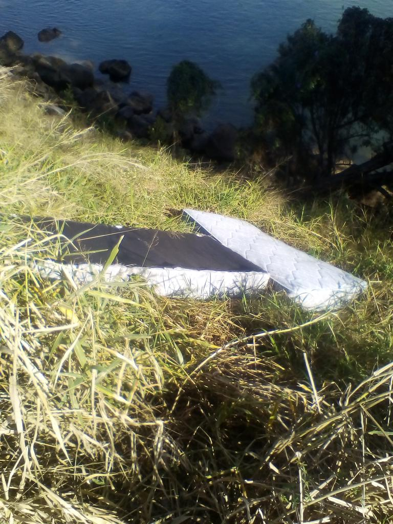 RIVERSIDE DUMP: Burnett River Clean's Glenn Rumsey found these items dumped near Kirby's Wall recently.
