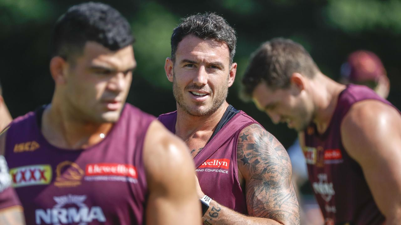 Darius Boyd keeps a close watch on in-demand teammate David Fifita at Broncos training. Picture: AAP Image/Glenn Hunt