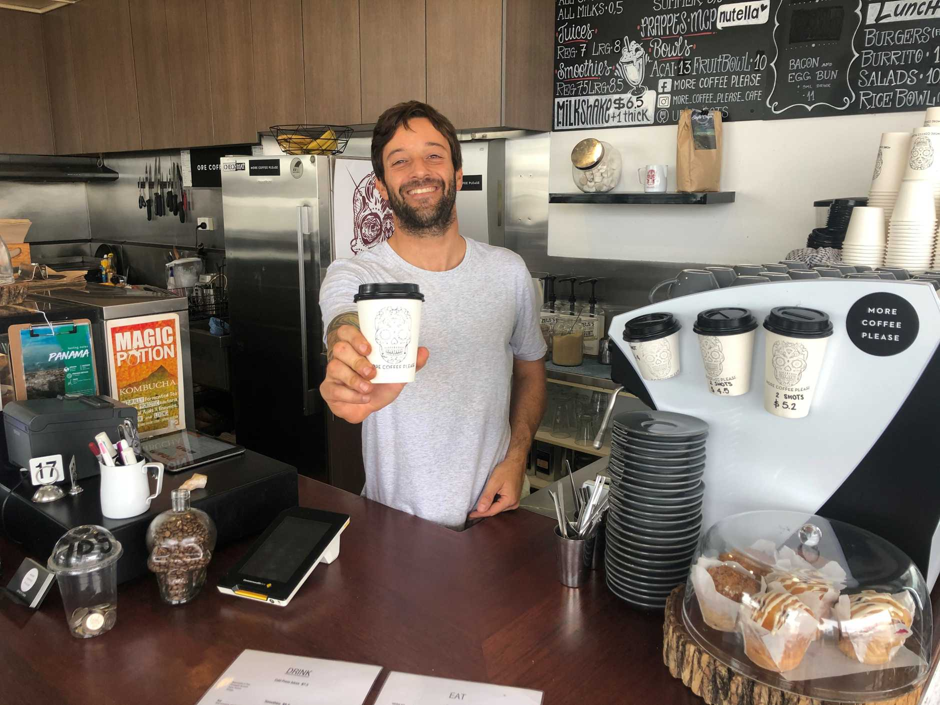 More coffee please cafe owner Felipe Castrabeche is having passengers of cars stuck in traffic get out and order coffee to drink while they wait.