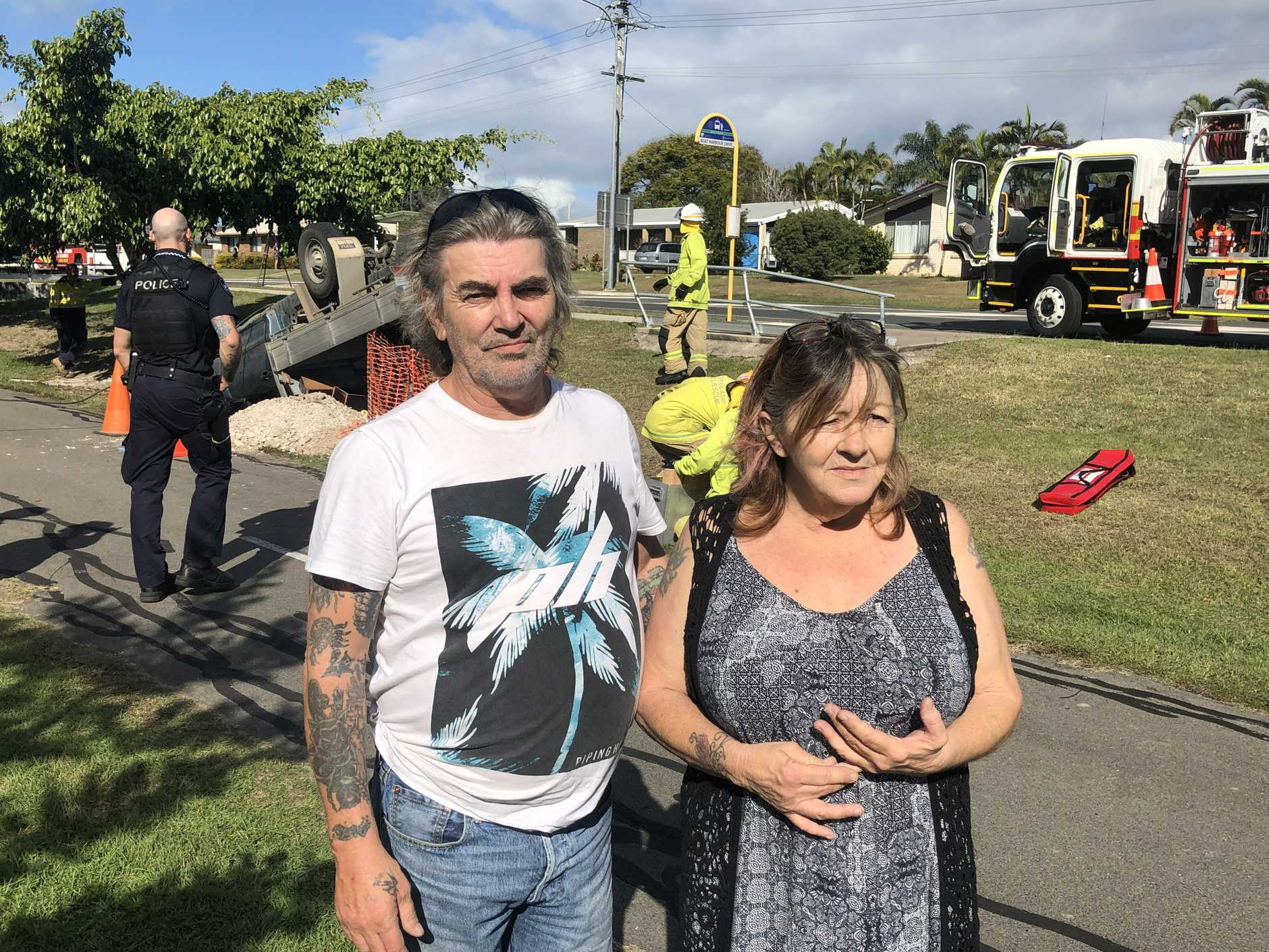 Boat Harbour Dr crash witnesses Paula and David, who were the first to respond when a man's ute flipped, trapping him inside.