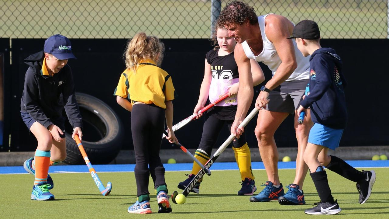 Grafton hockey legend Brent Livermore joined juniors during a school holiday hockey clinic at the Grafton fields on Thursday. Photo: Suellen Jenkins