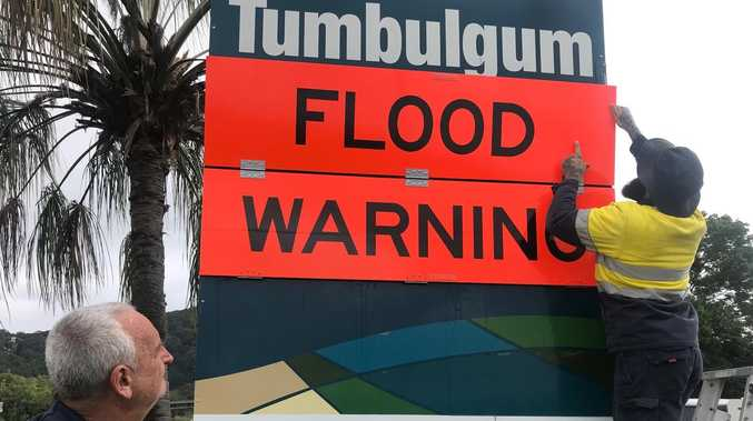 Village to manage 'in your face' flood warning signs