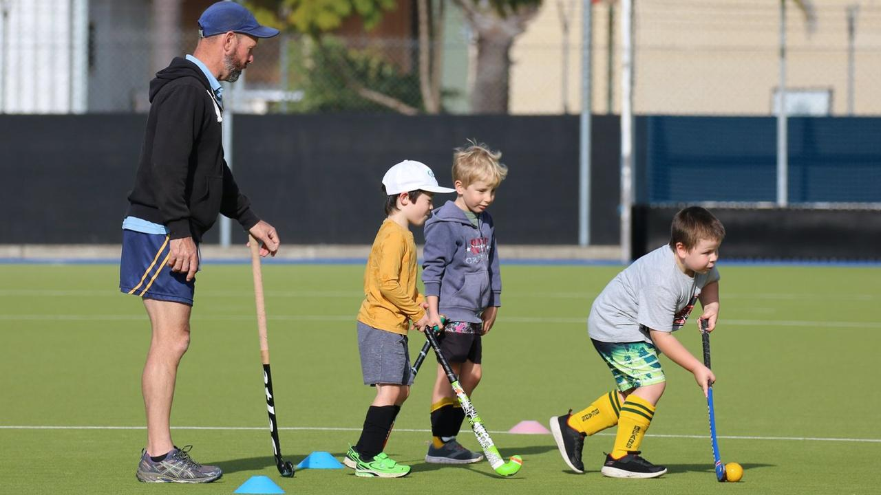 Rick Sampson leads the group during a school holiday hockey clinic at the Grafton fields on Thursday. Photo: Suellen Jenkins