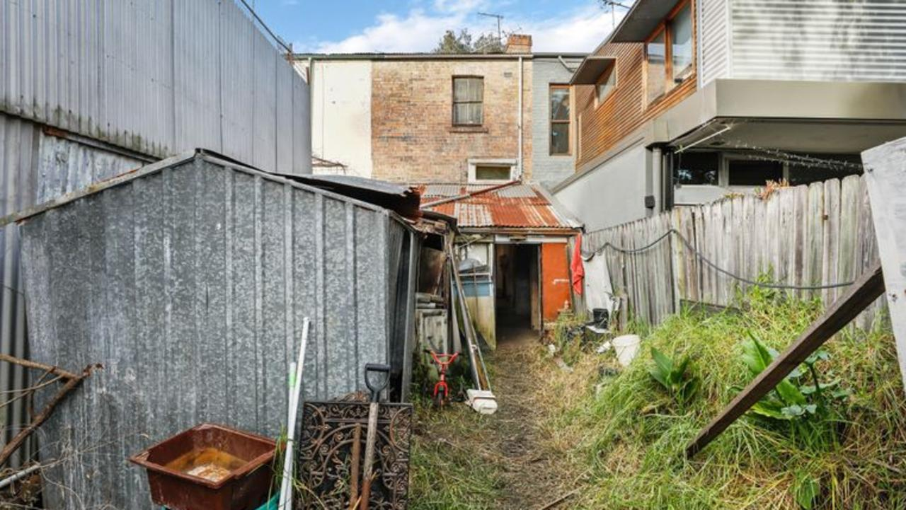 A grubby terrace in a popular spot has hit the market missing a bathroom and with an old cabinet propping up part of the roof. It has to be seen to be believed.