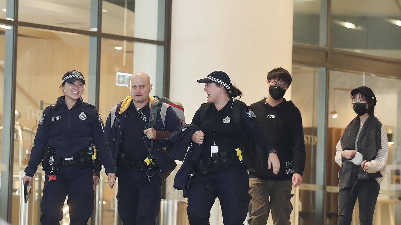 Police officers patrol a quarantine hotel in Brisbane's CBD. Picture: Annette Dew