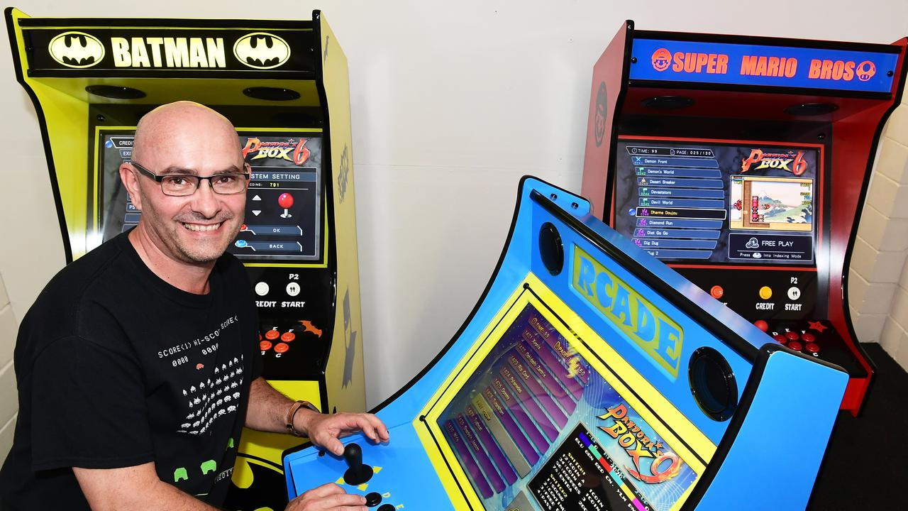 Rob Lutz with a few of his custom built arcade games.