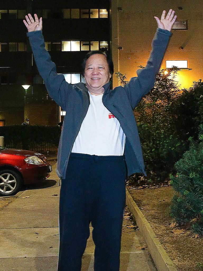 Richard Tam raises his hands in relief after five days in lockdown. Picture: Ian Currie