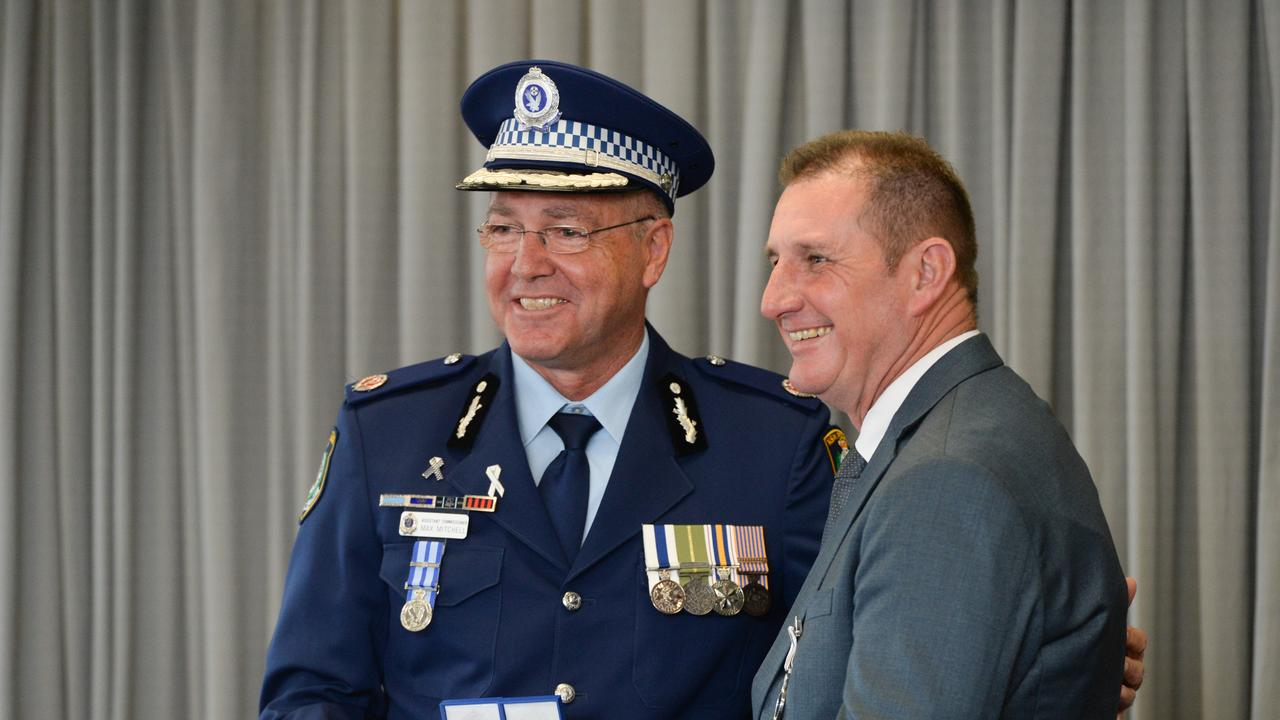 Assistant Commissioner Max Mitchell presents Sergeant Joseph Roach with an award at the Coffs/Clarence 2019 police award ceremony.