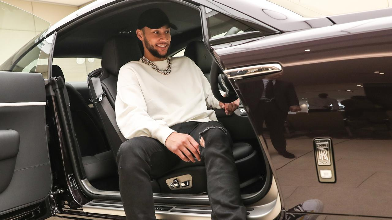 Aussie basketball star Ben Simmons at the wheel of a Wraith at a Melbourne dealership. The Philadelphia 76ers point guard reportedly owns multiple Rolls-Royce vehicles. Picture: Supplied/Fiona Byrne