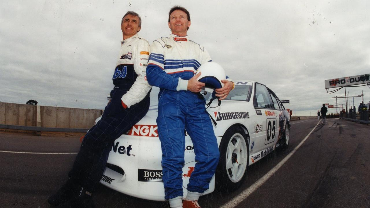 SA rally champion Ed Ordynski with Peter Brock and his Holden Commodore at Mallala race track in 1995.