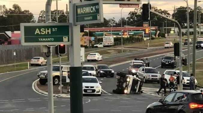 Person taken to hospital after car flips onto its side