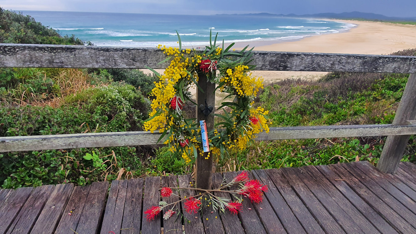 A wreath laid at Wilsons Headland where 15-year-old Mani Hart-Deville was killed by a shark while surfing with friends on Saturday, 11th July, 2020.