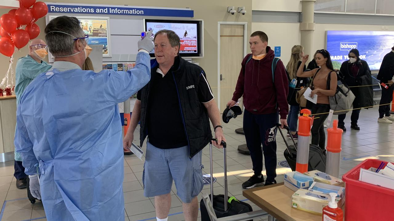 Jetstar passengers having their body temperature checked by NSW Health at Ballina Byron Gateway Airport on July 3.