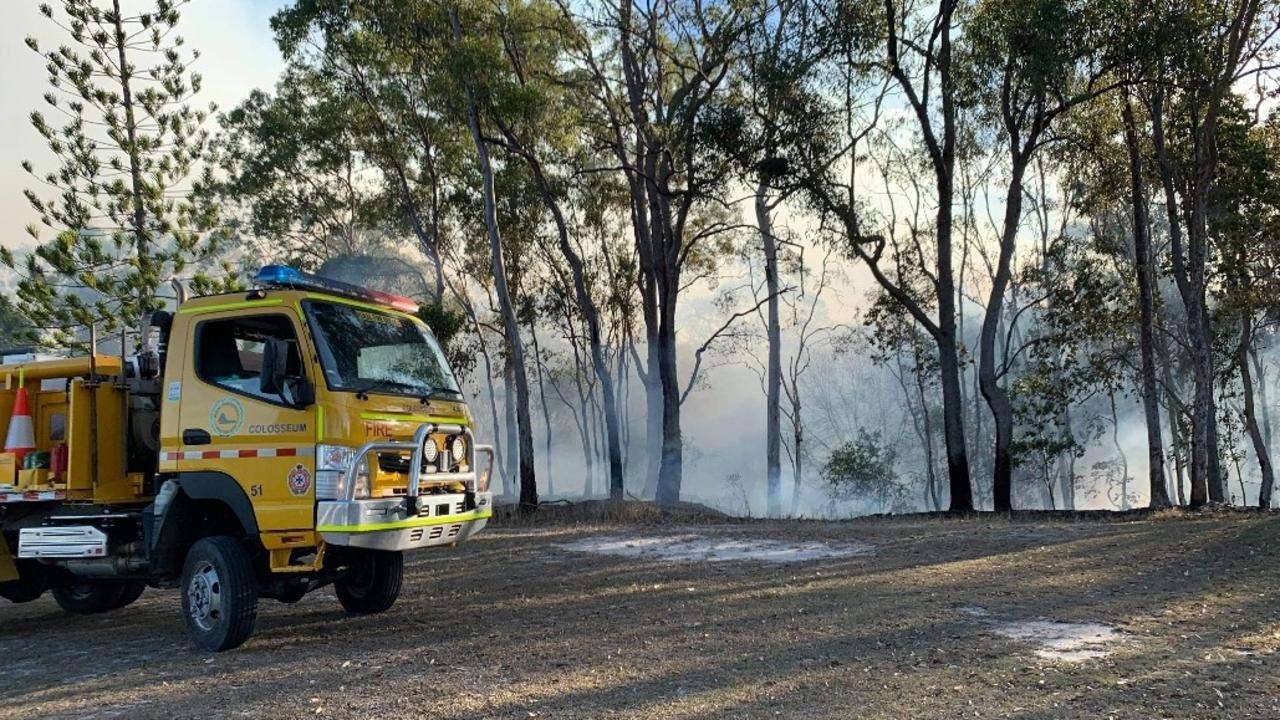 Fire crews work a controlled burn at the Miriam Vale Golf Club this afternoon.
