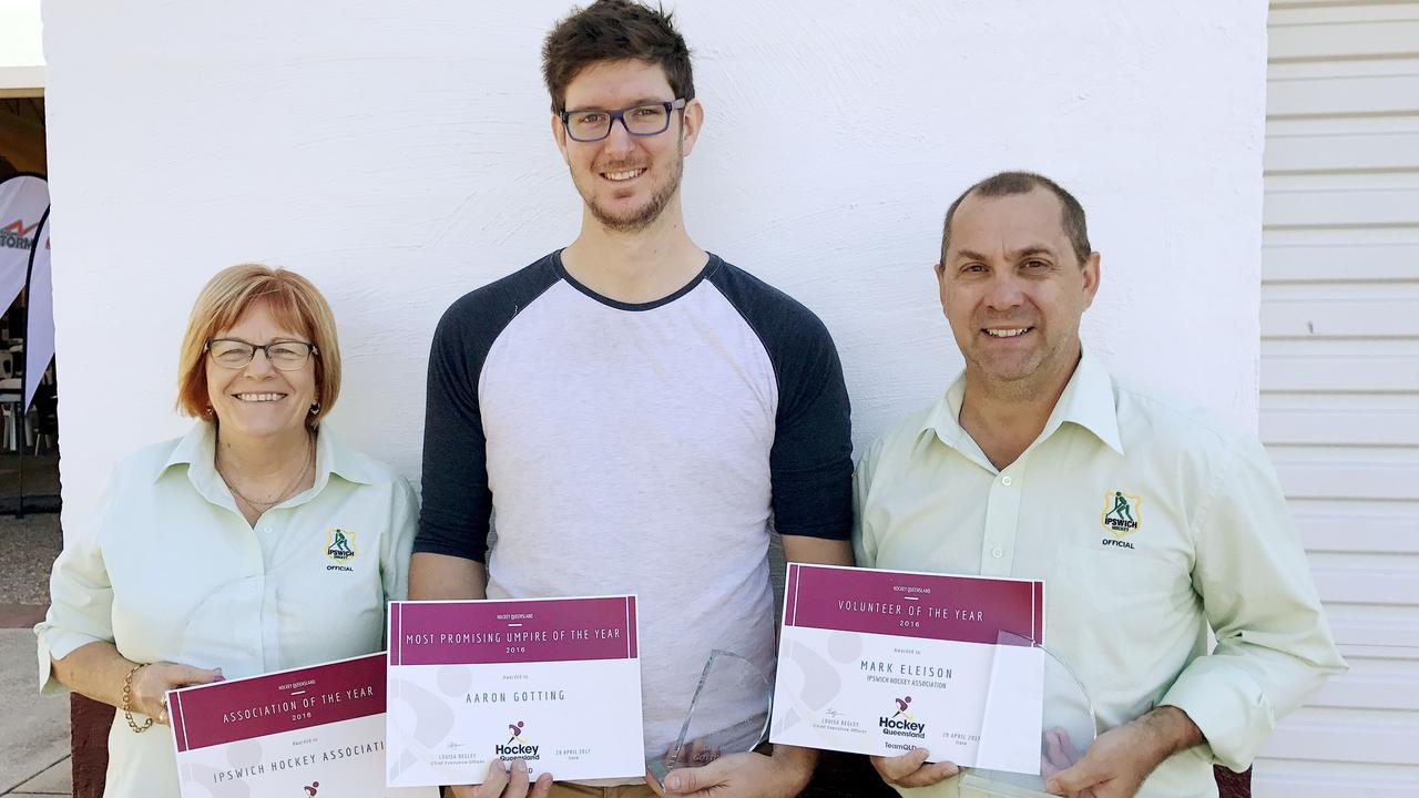 Previous Hockey Queensland award winners (from left) Association president Margret Mantell, promising umpire Aaron Gotting and volunteer of the year Mark Eleison.