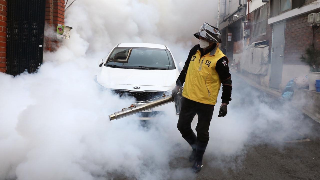 A worker disinfecting the streets of Seoul in South Korea trying to prevent a coronavirus second wave. Picture: Chung Sung-Jun/Getty Images.