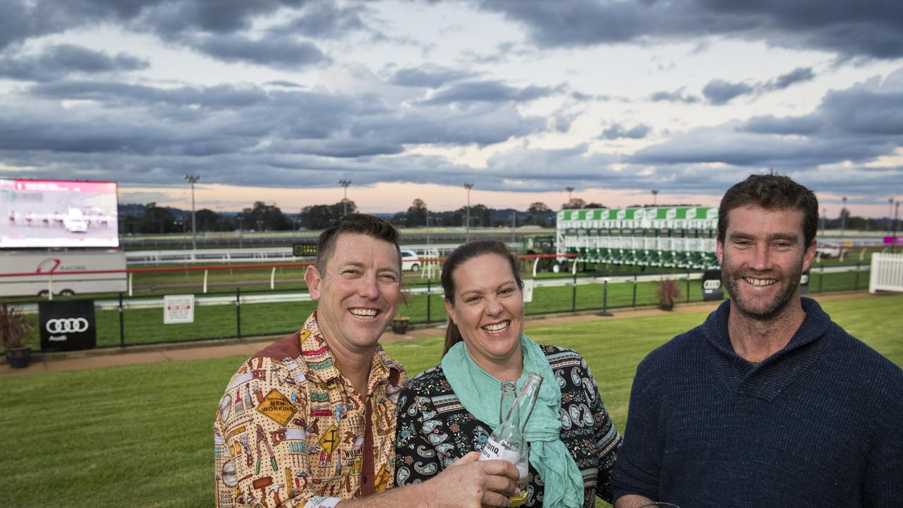 TRACKSIDE: Preparing for the start of the evening races at Clifford Park Racecourse are (from left) Tim Lomman, Jackie Grills and Mick Grills. Picture: Kevin Farmer