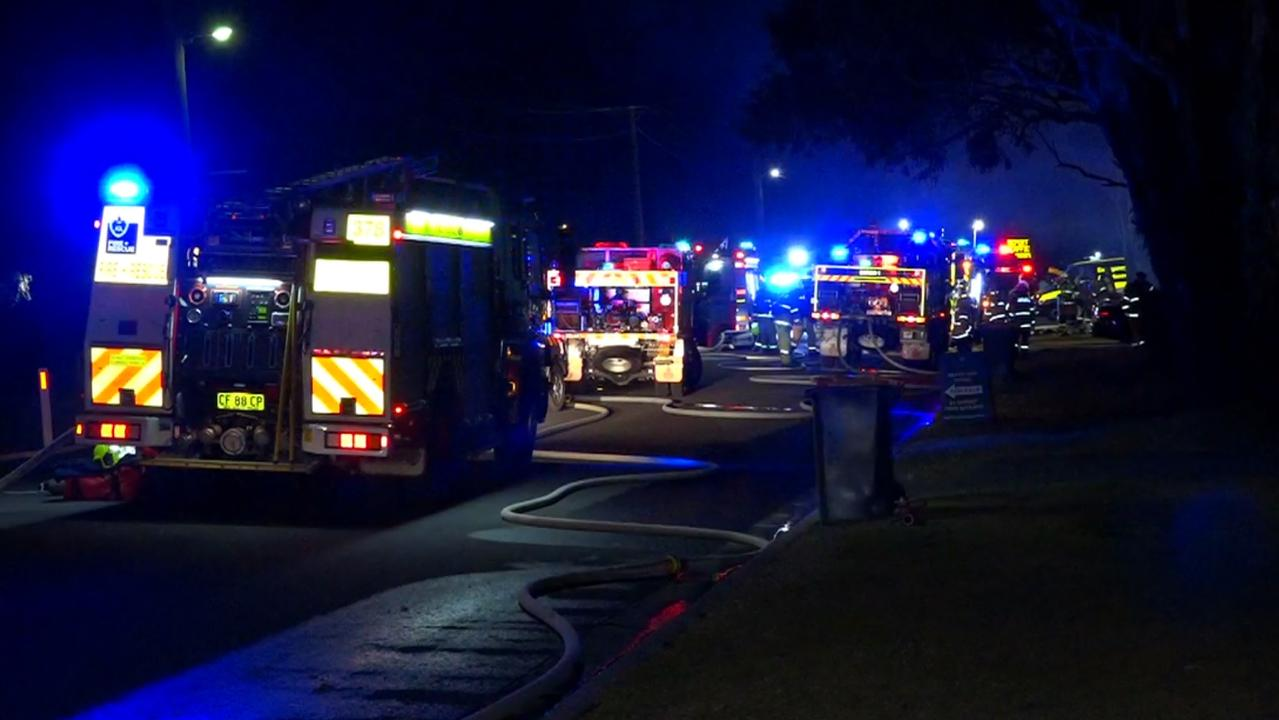Fire crews on the scene where a baby has died in a house fire. Picture: TNV