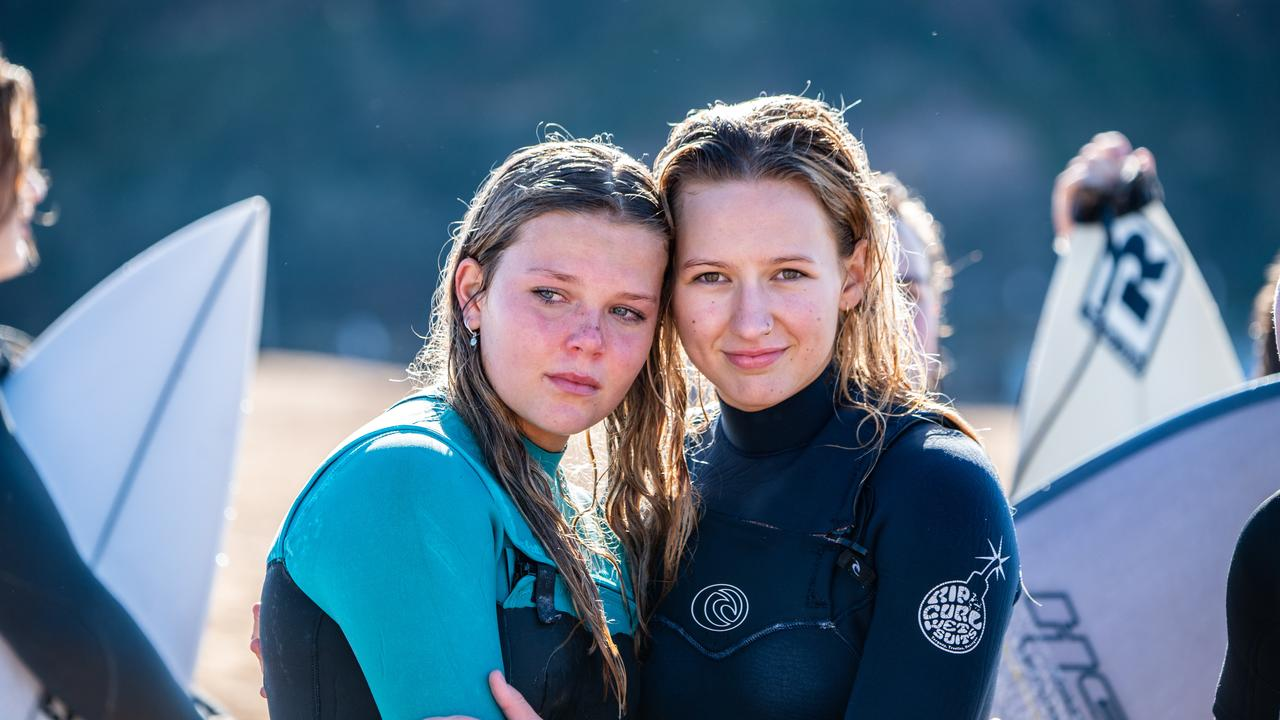 Zoe Bardy on the left photographed with a friend at the memorial 'Paddle Out for Chumpy' held at North Narrabeen Beach. Picture: Monique Harmer