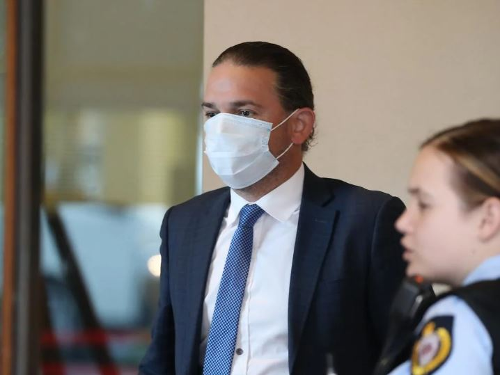 Steven Prestage gets a temperature check before entering Downing Centre Courts on July 9. Picture: NCA NewsWire/David Swift