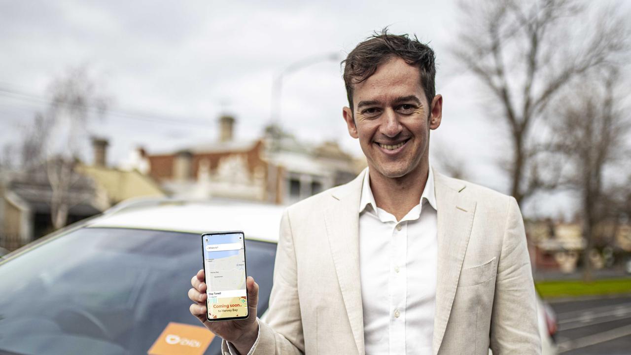 DiDi Australia's Head of Public Relations, Dan Jordan, with the DiDi app.