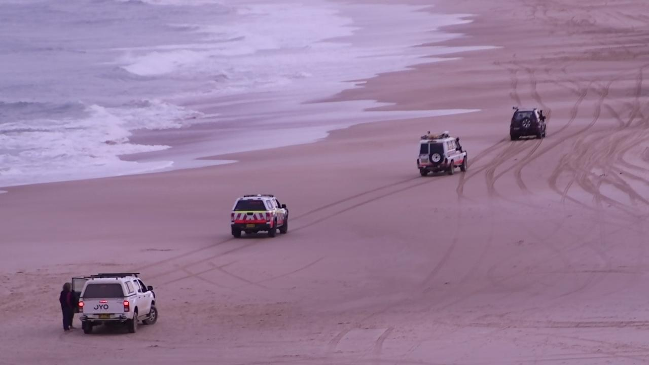 AFTERMATH: Emergency services at the scene of the fatal shark attack on Saturday, July 11 at Wilson's Headland, Wooli NSW.