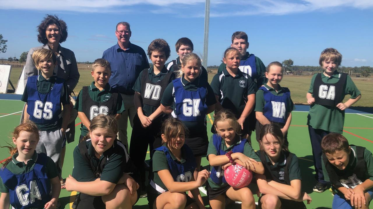Principal Elizabeth Jacobson and Barry O'Rourke at Depot Hill State School alongside its talented netball team.