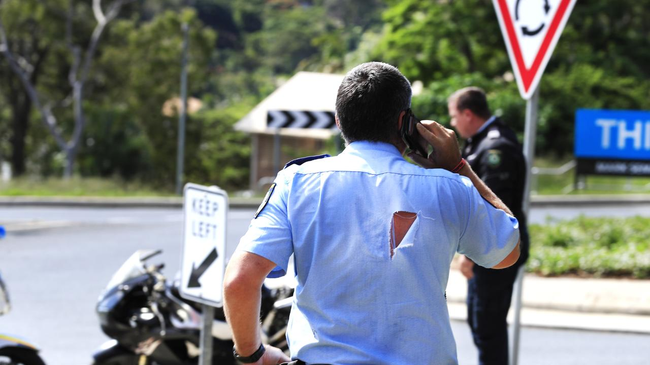 A NSW Police Officer with a torn shirt as a result of arresting the rider of a motorbike allegedly displaying the wrong plates. NSW Police had been pursuing the bike when it crashed after taking a corner too fast on the corner of Fraser Drive in Terranorra. Photo: Scott Powick