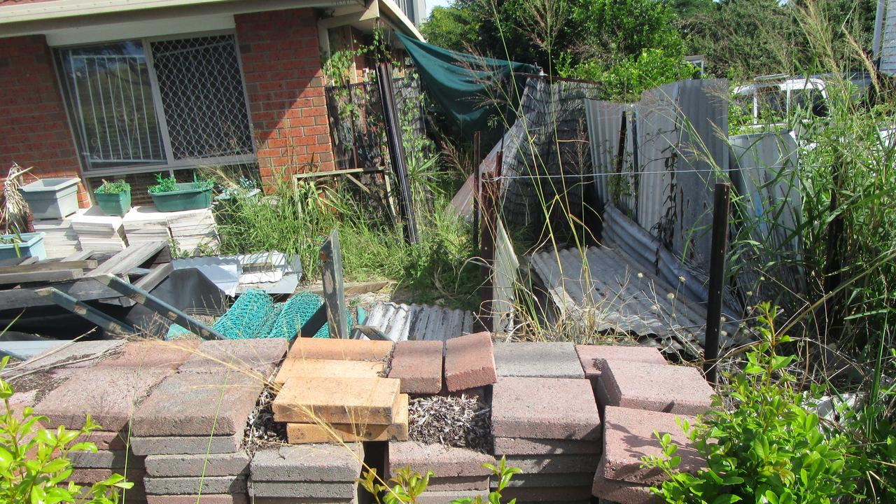 Piles of pavers and other material. One part of the garden had grass 2m high and inspectors could not get through it.