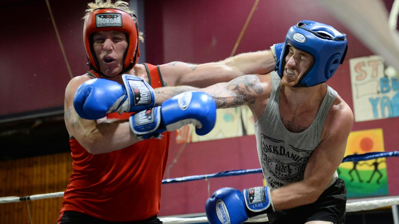 81kg fighters Shane Allan (PCYC) and Torin O'Brien (Rhino) trade blows. Photo Allan Reinikka / The Morning Bulletin