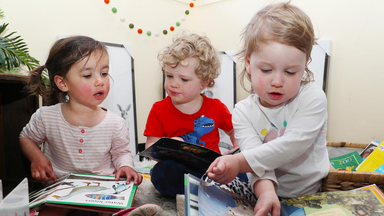 Toddlers reading books together. Picture: David Crosling