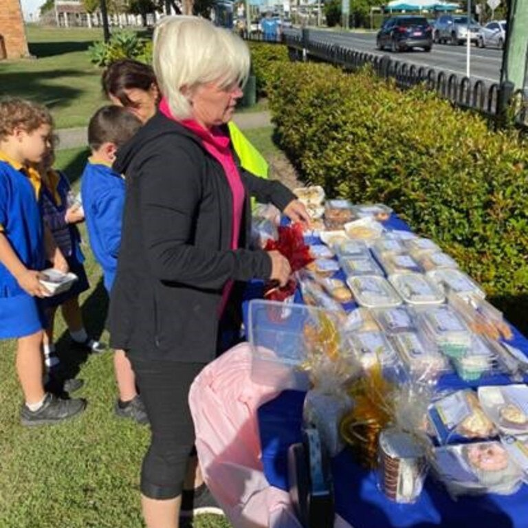 Mackay West State School teacher aide Dolly Whitestyles serving parents and students at the bake stall. Picture: Contributed.